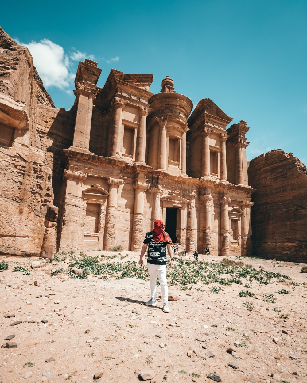 man standing beside Petra at daytime