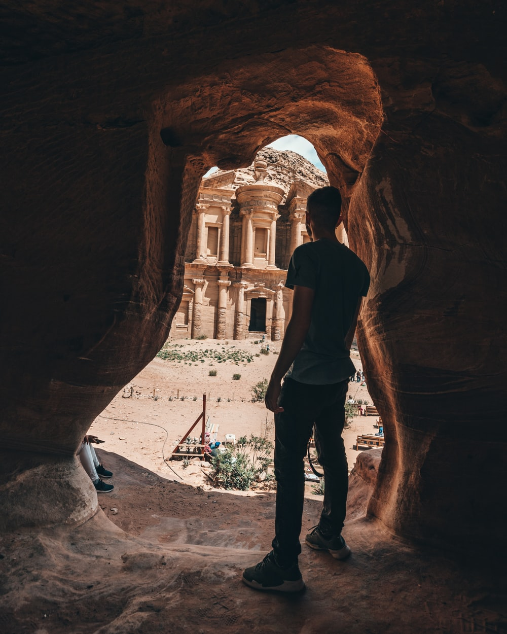 man standing inside cave