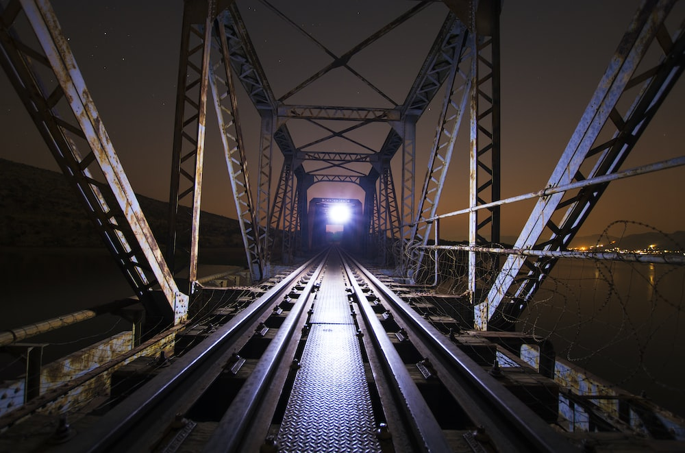 shallow focus photo of train during nighttime