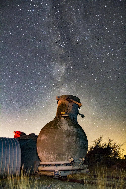 concrete vase-shaped building under starry night