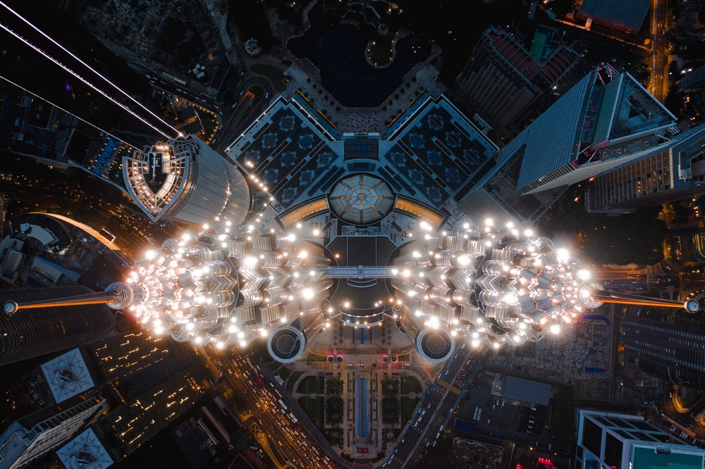 aerial photography of city buildings with lights turned on