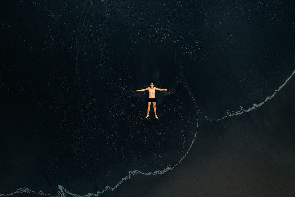 man lying on water