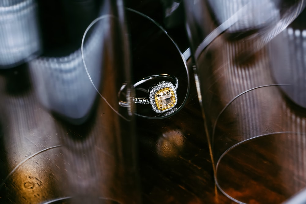 silver and gold ring on desk