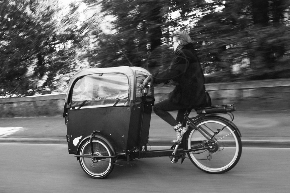 man riding trike