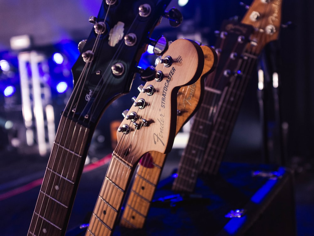 selective focus photography of brown electric guitars