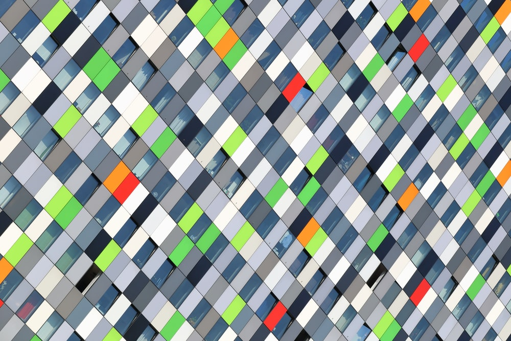 closeup photography of multicolored geometric tiles