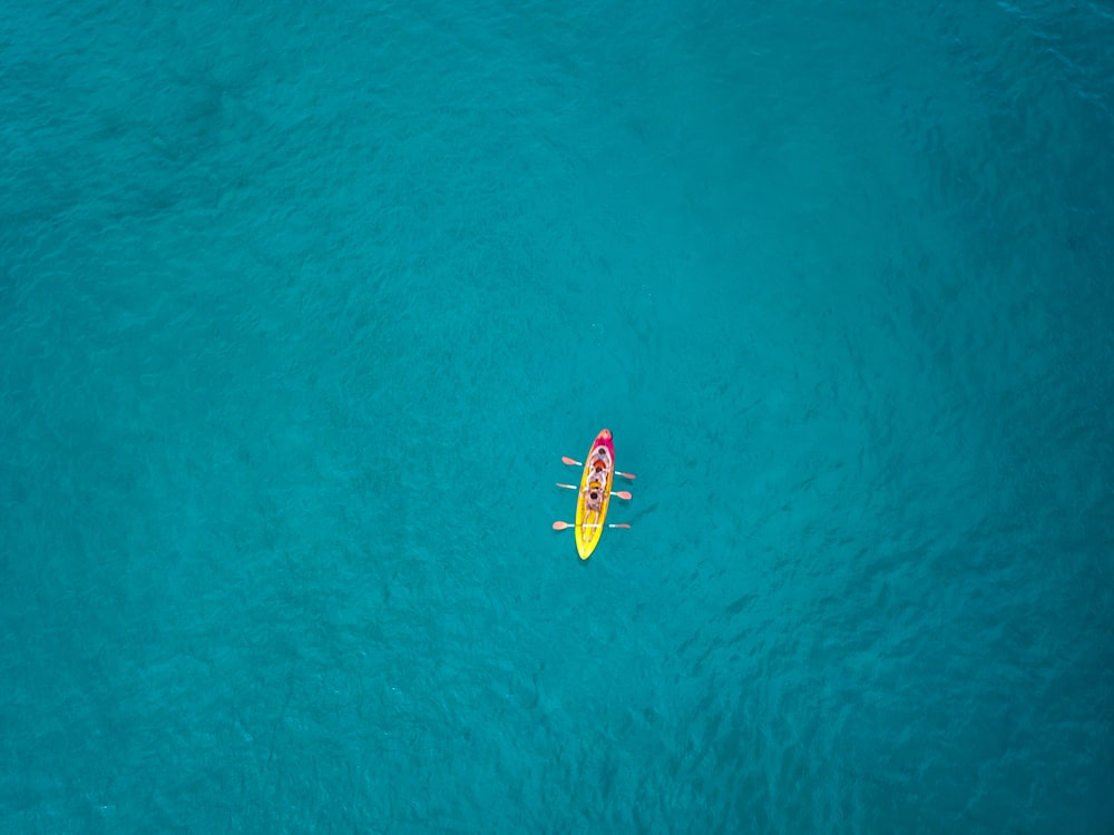 aerial view photography of boat on water