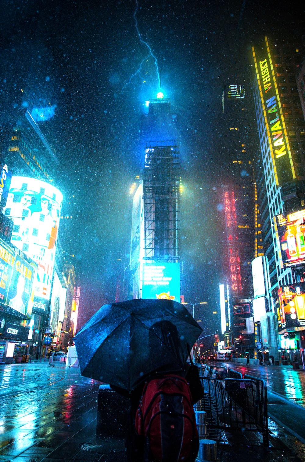 woman carrying umbrella