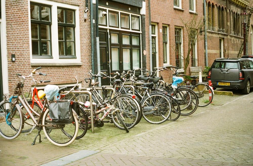 assorted-color bike lot on brown building