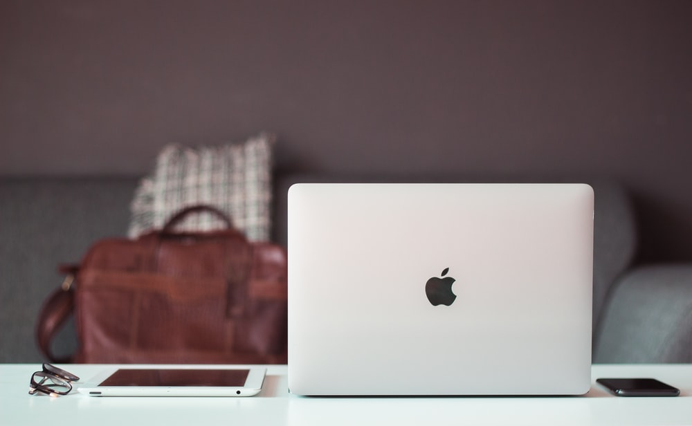 Apple Macbook Air and iPad on table