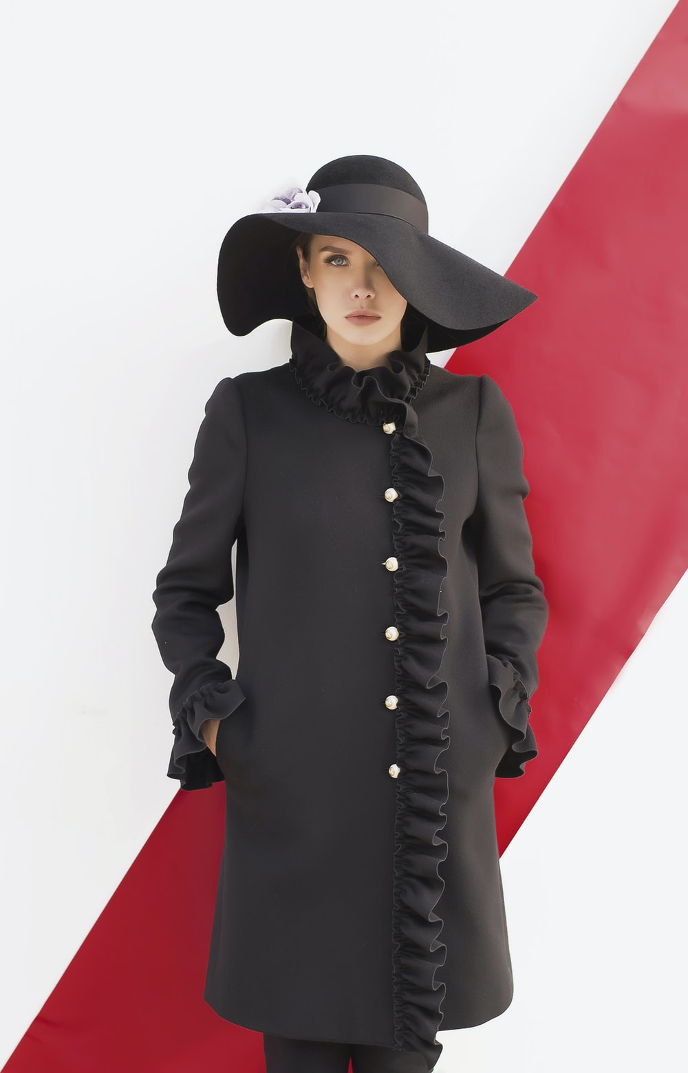 woman wearing black long-sleeved dress and black sunhat
