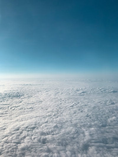 white clouds covering ground below