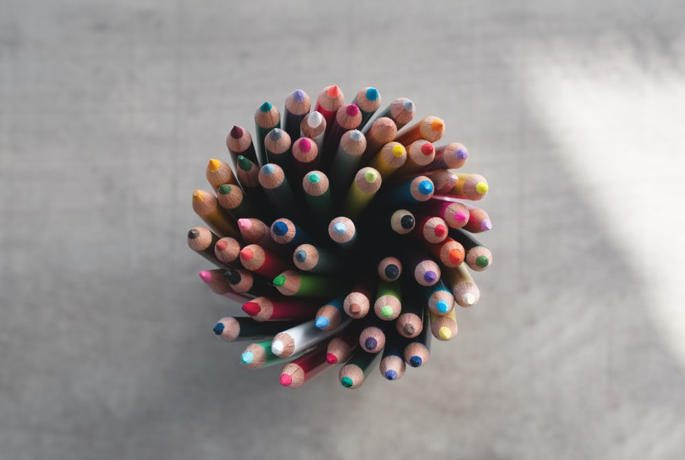 high-angle photography of color pencil lot