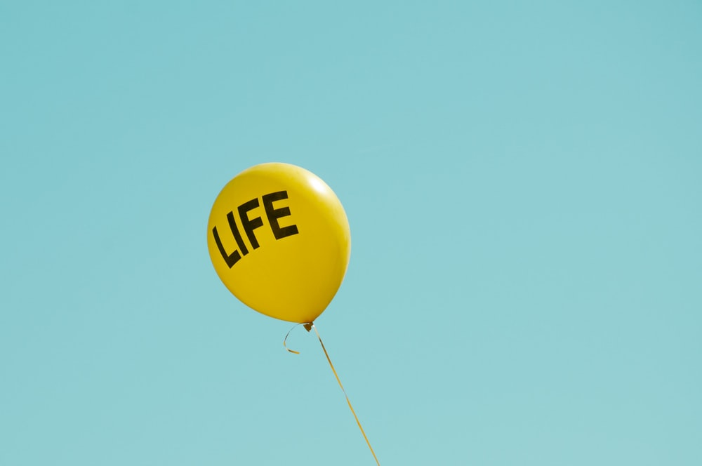 yellow life-printed balloon