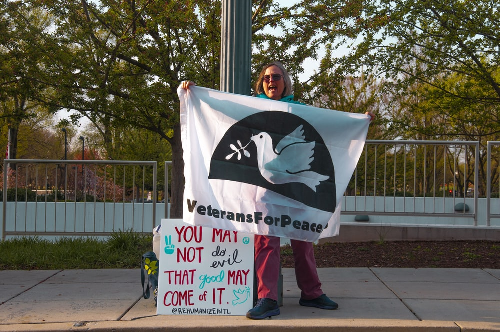 woman showing veterans for peace banner
