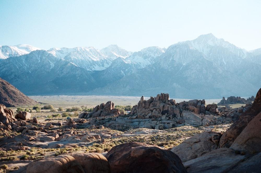 snow capped mountain range across brown mesa