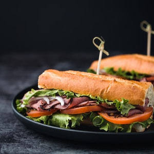 vegetable and meat sandwiches i9n plate