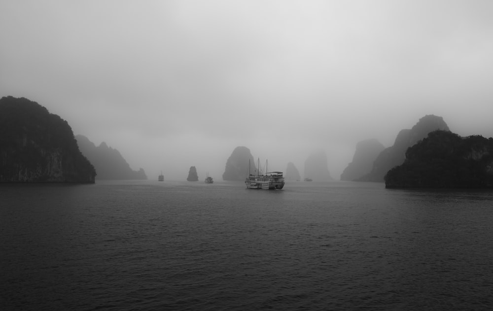 grayscale photography body of water