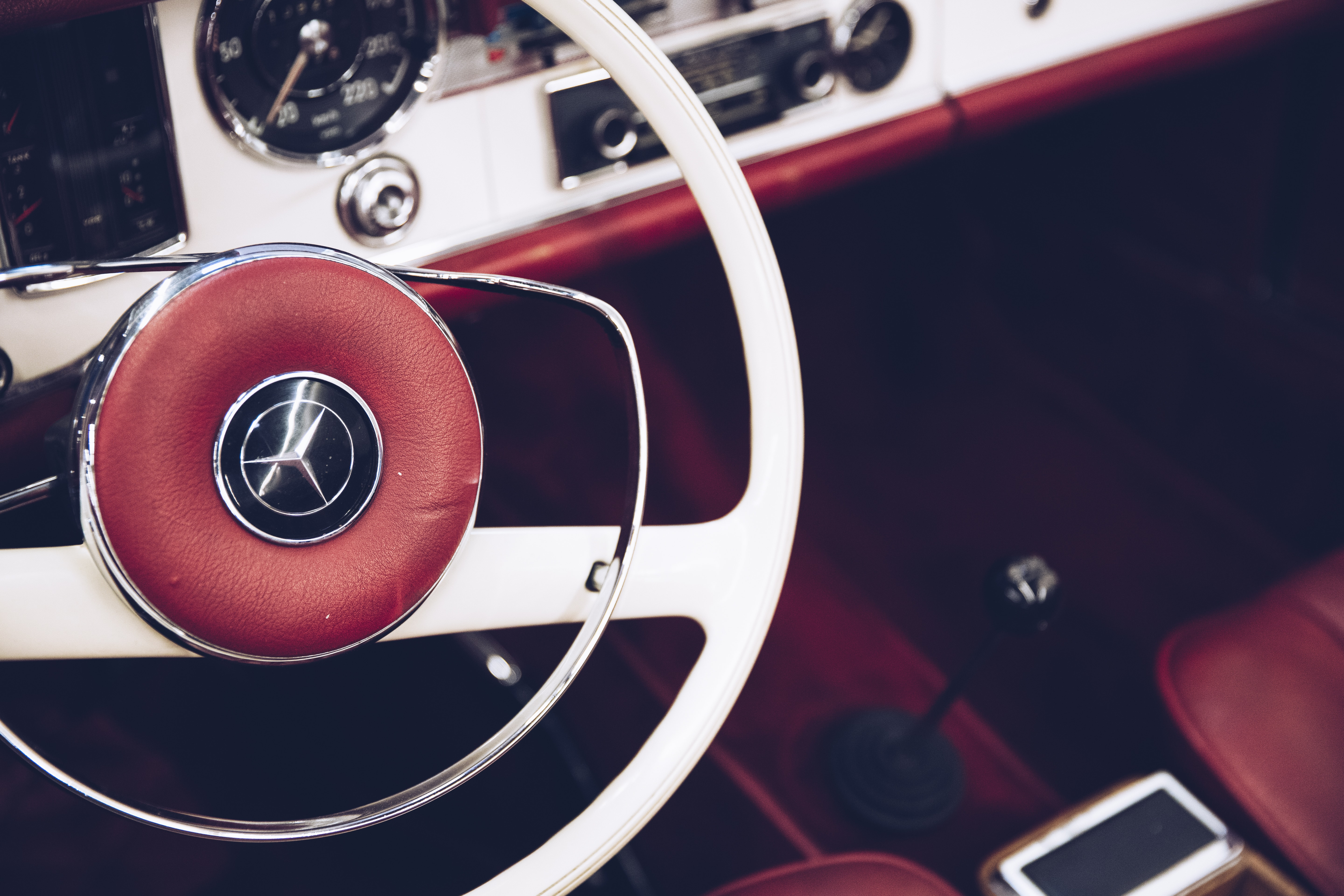 red and white Mercedes-Benz vehicle interior