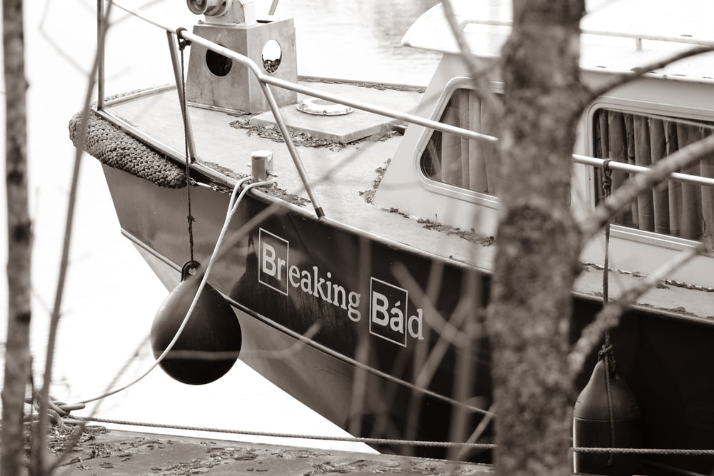 grayscale photography of speedboat