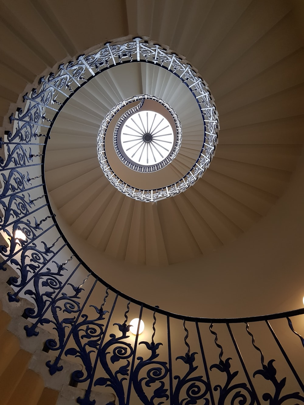 low angle photography of spiral stairs