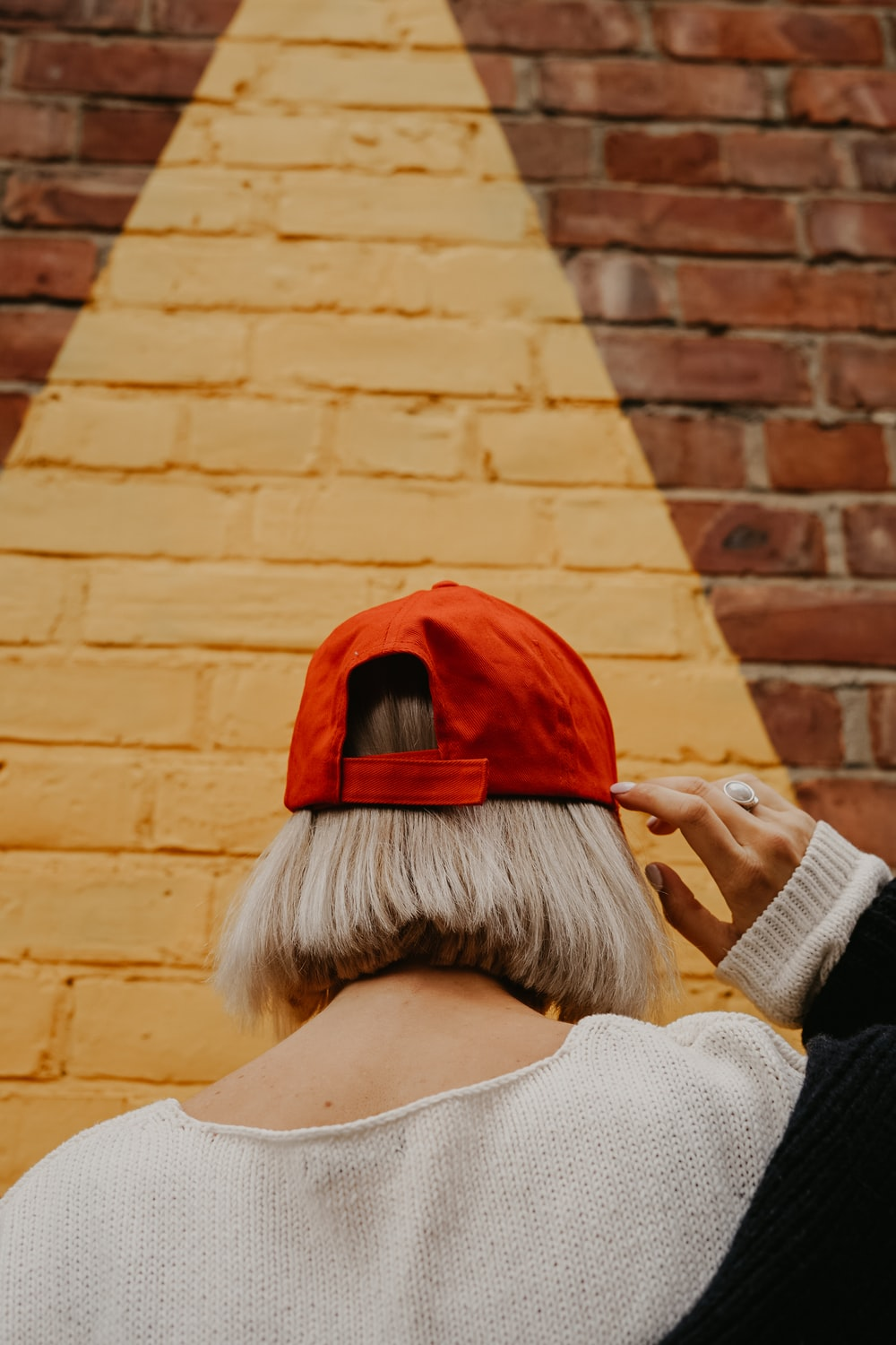 woman holding red cap