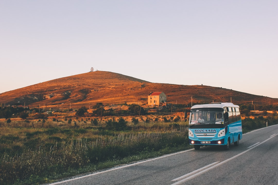 Sunset on the beautiful little island Bozcaada in Turkey. A bus passes by the island's radar unit.