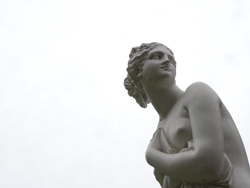 topless woman statue