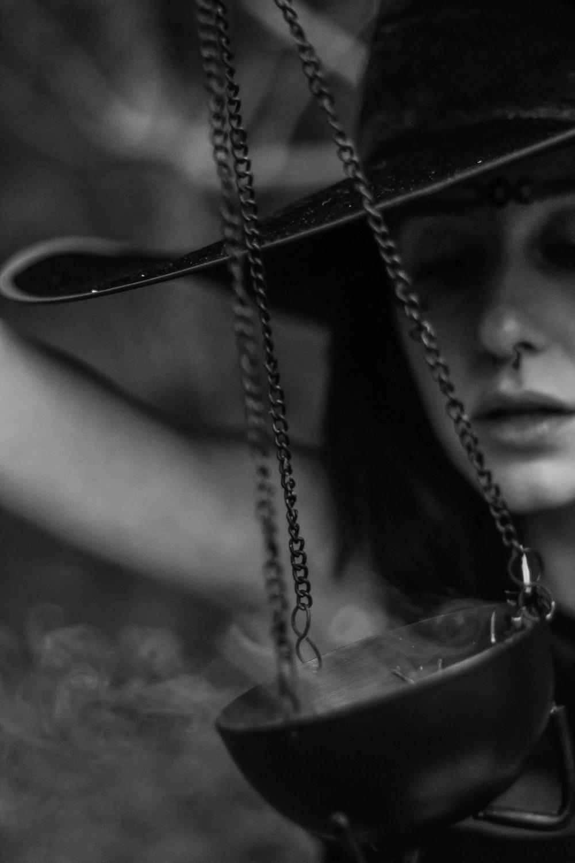 woman holding pot with smoke