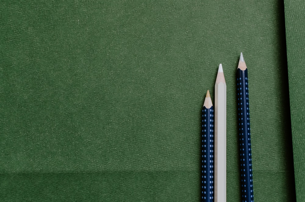 white and blue pencils