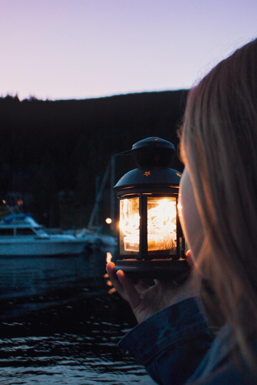 girl holding lamp
