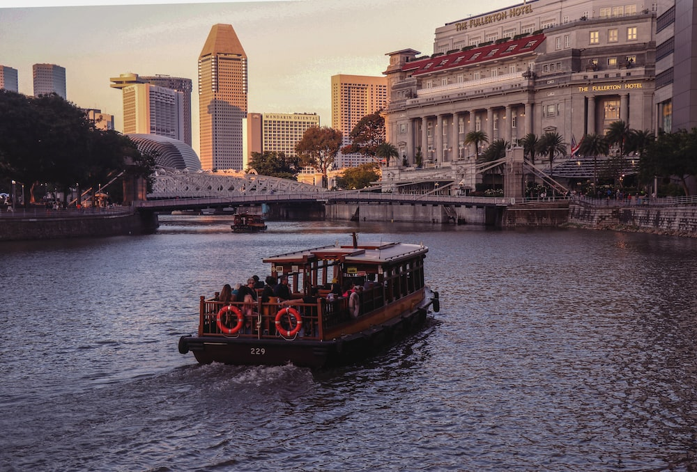 black and brown boat on river during golden hour