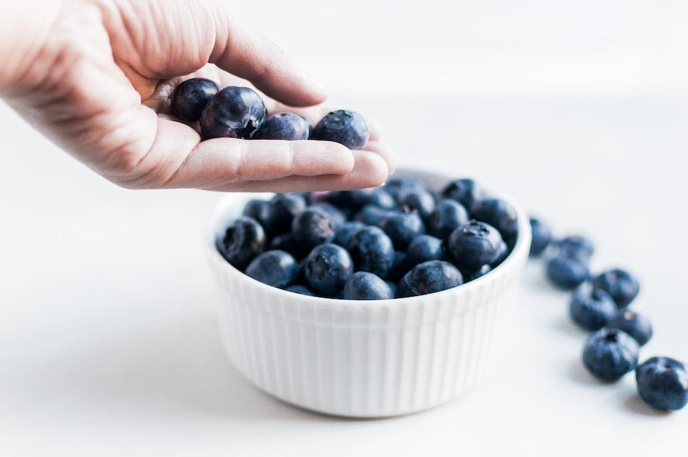 blueberries on white ceramic ramekin