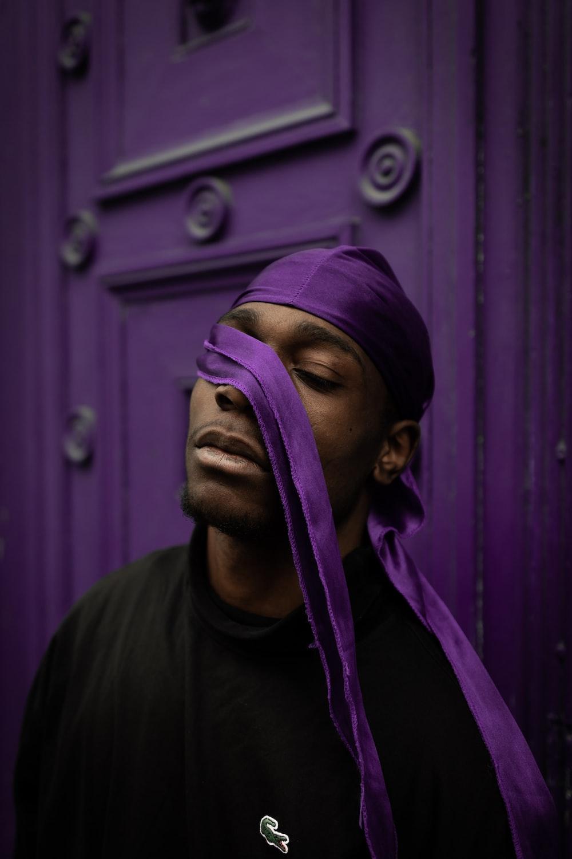 man in purple cap