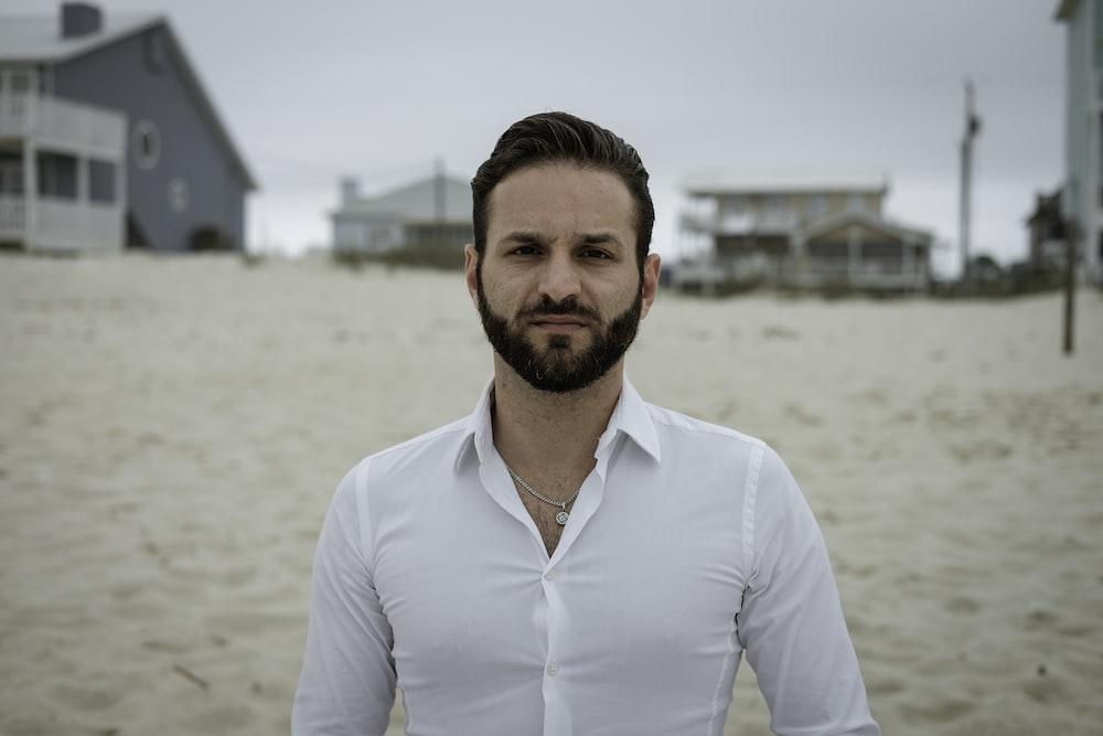 man standing on white sand