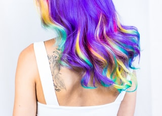 woman in white top with multicolored hairstyle