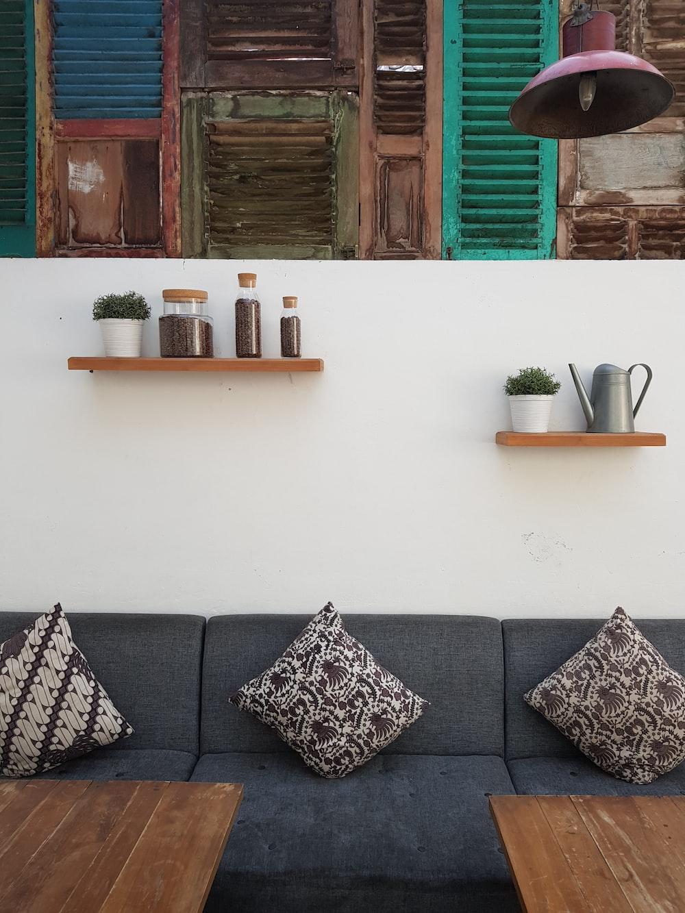 pillows on black suede sofa period home interior design