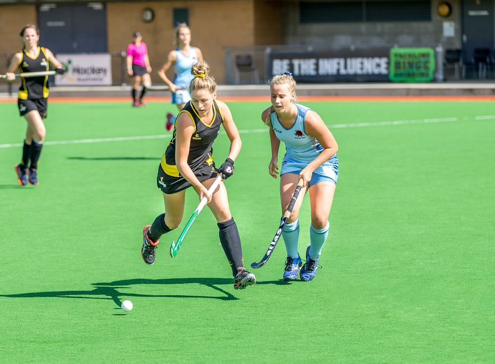 women playing outdoor sports