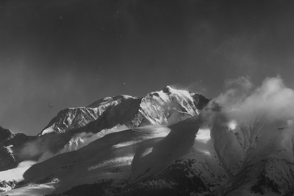 grayscale photography of snow-covered mountain