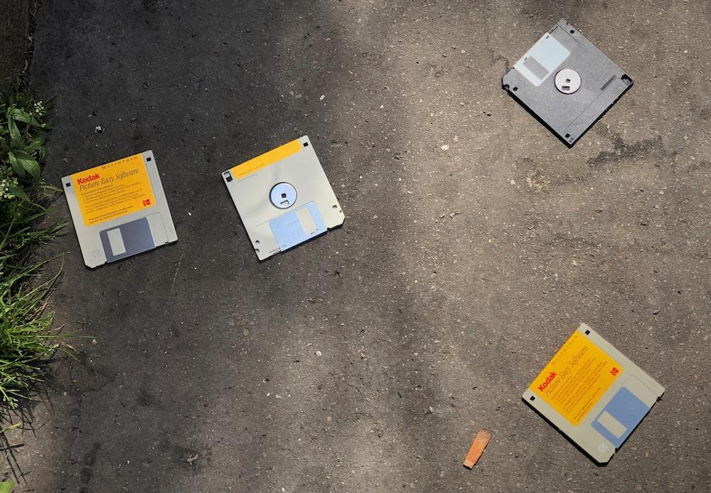 four diskettes on ground