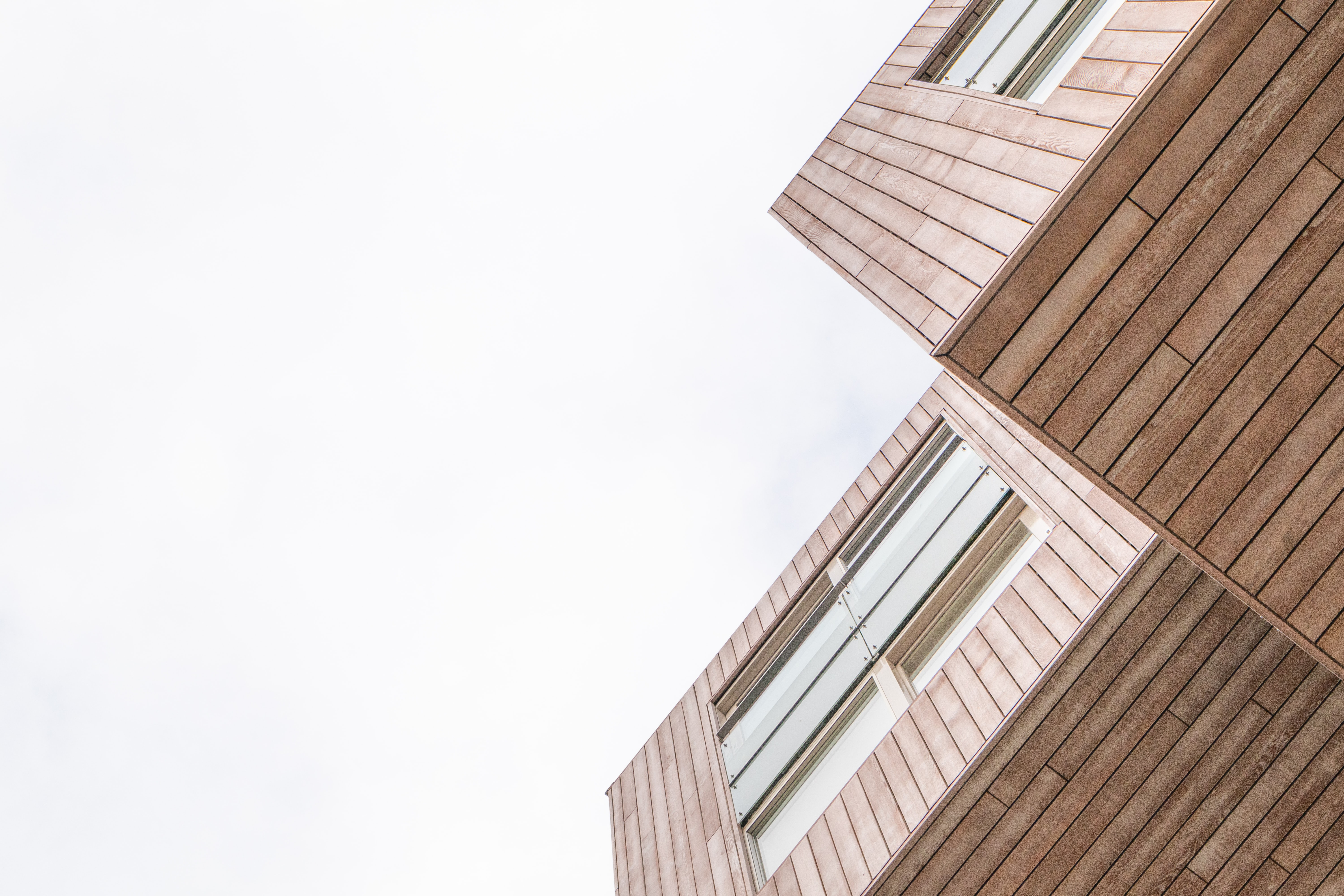low angle photography of brown building structure
