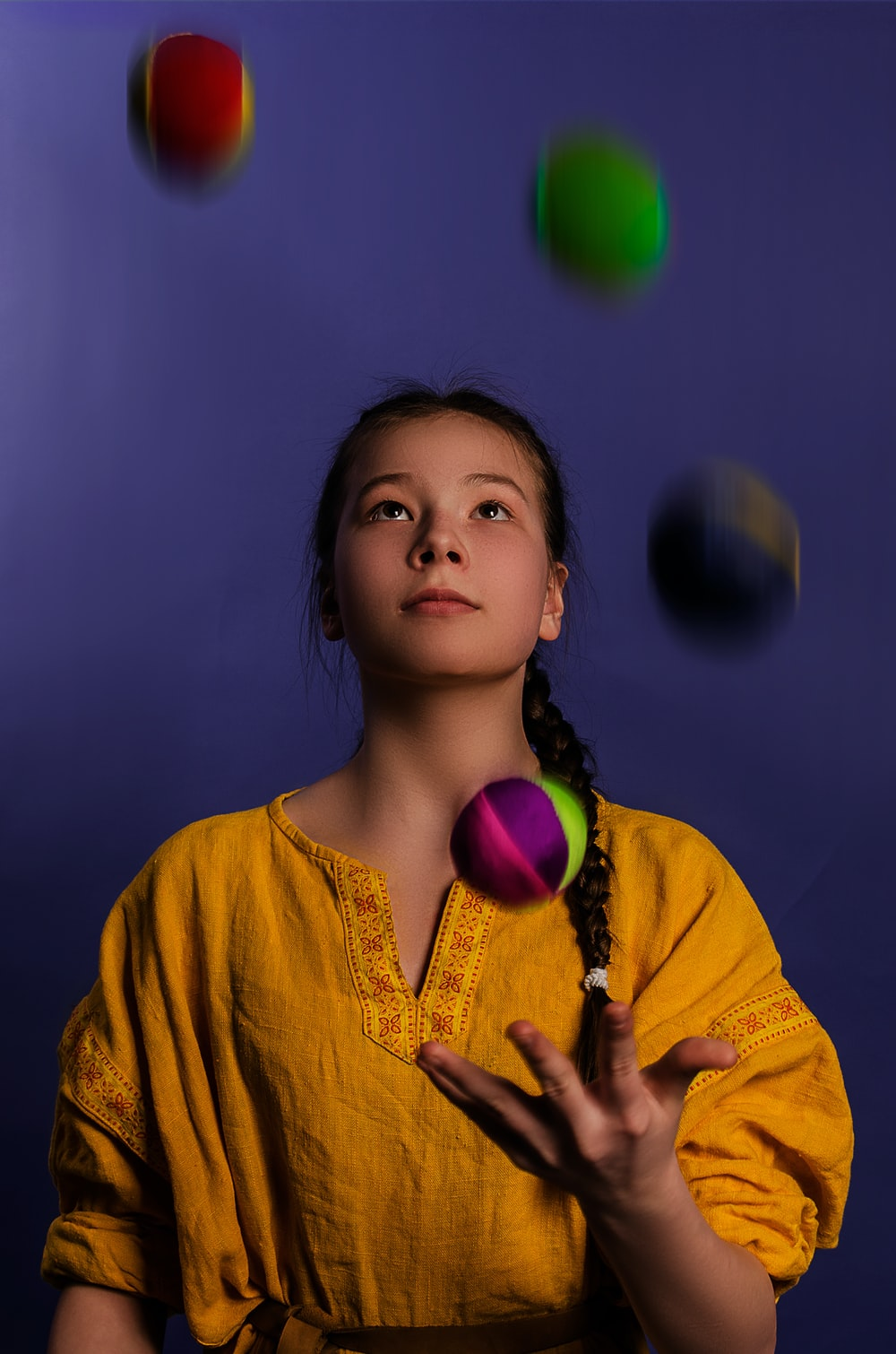 woman playing assorted-color balls