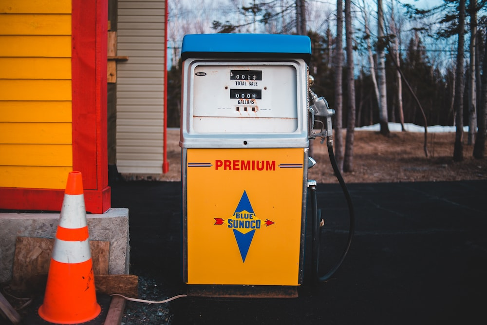 white and yellow Premium gasoline station