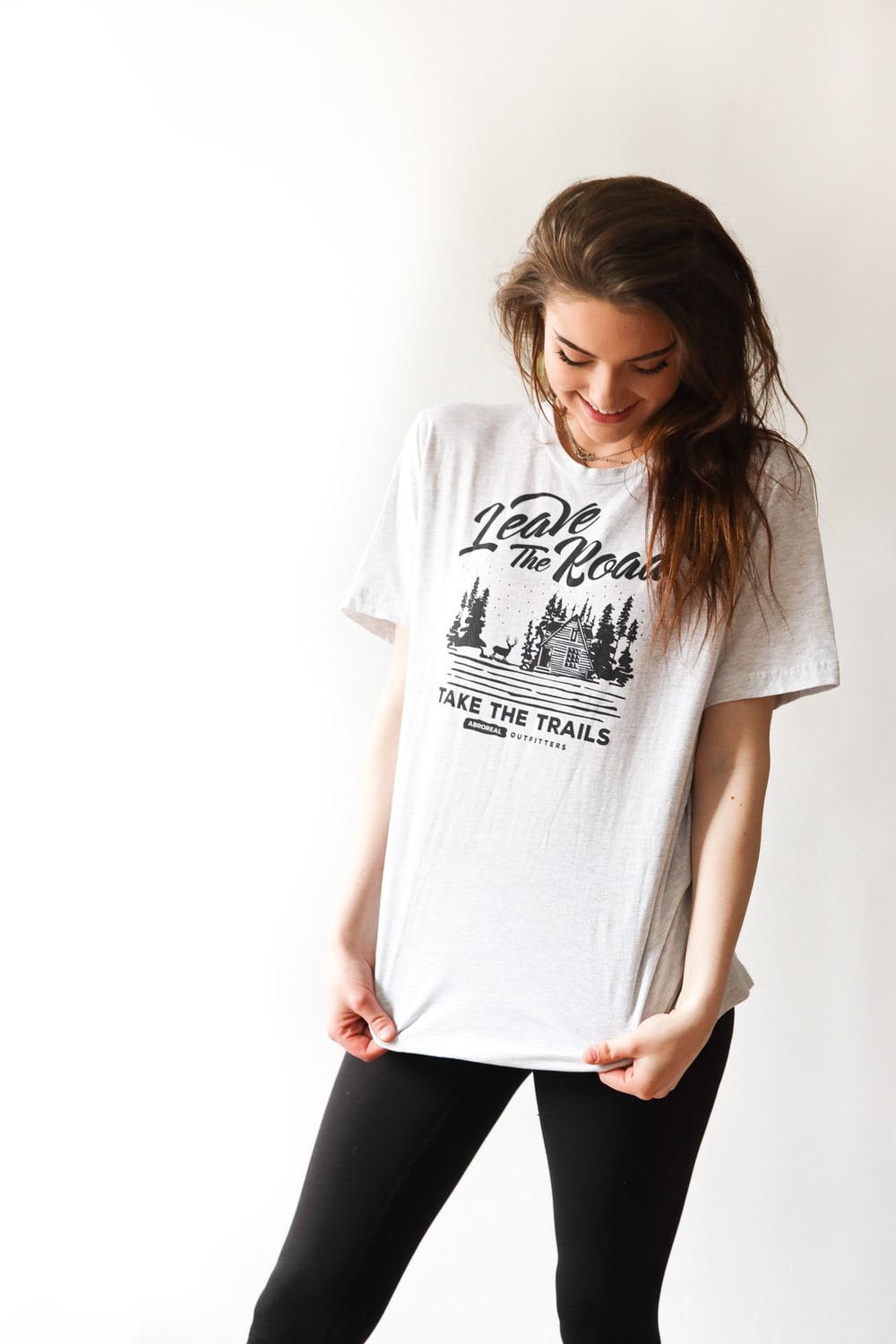 smiling woman in black and white print t-shirt