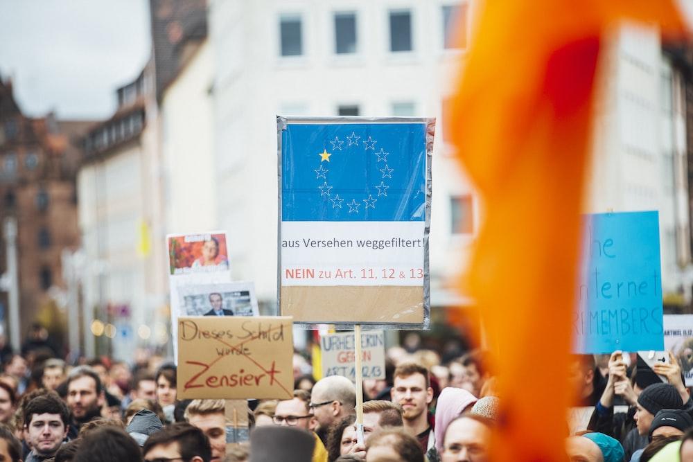 people holding signage
