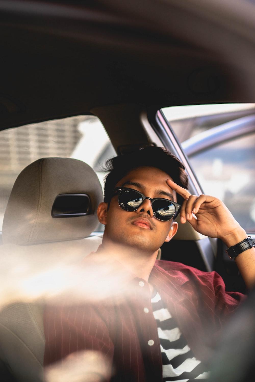 man in sitting on car seat