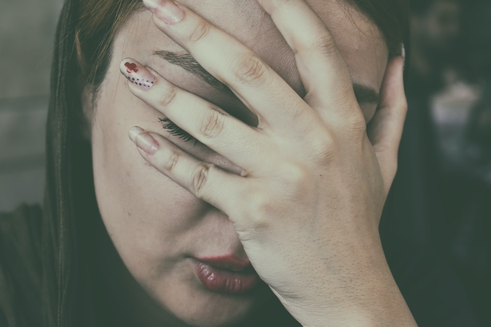 woman's hand on face
