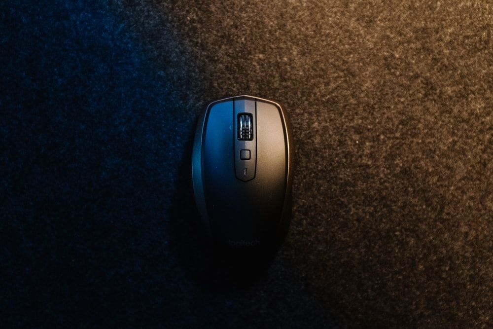 black wireless mouse on black textile