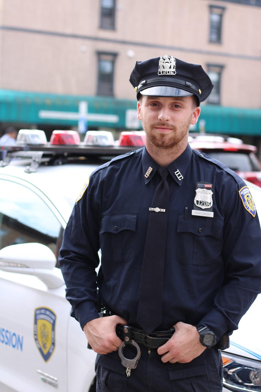 selective focus photography of policeman