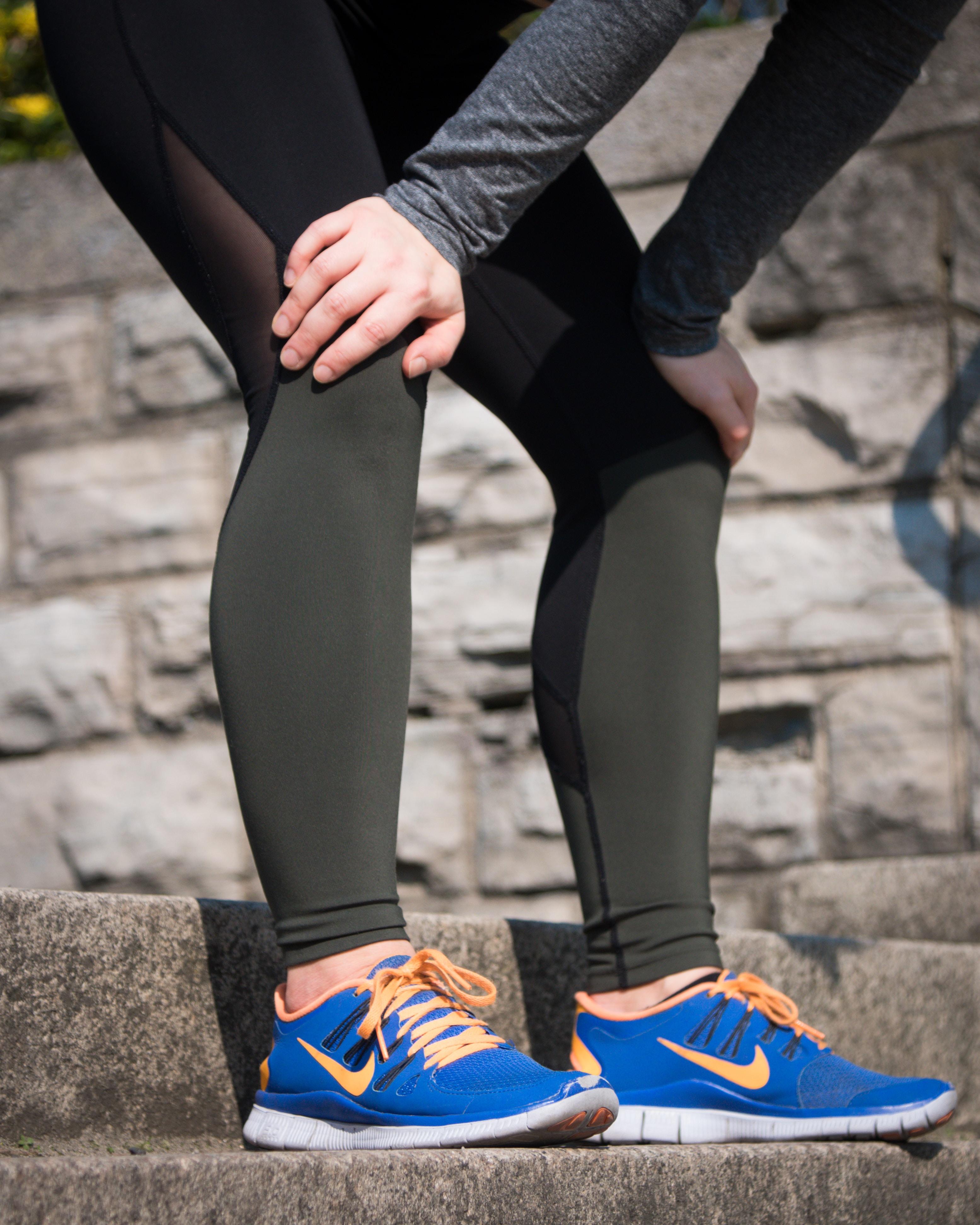 orange-and-blue Nike running shoes
